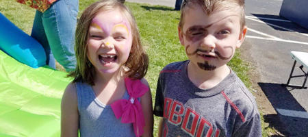 Kids With Drawings On Their Faces